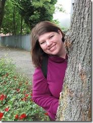 angie behind tree